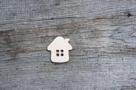 Photo pour Toy wooden house on a natural wooden background. Concept photo about buying real estate in nature. - image libre de droit