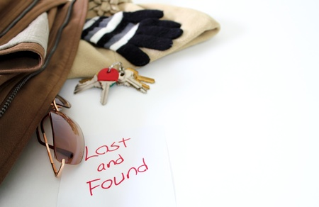 Various items over white to illustrate a lost and found concept.