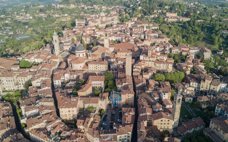 Drone aerial view of Bergamo - Old city. One of the beautiful cities in Italy. Landscape on the city center, the main square and its historic buildings during a wonderful blue day
