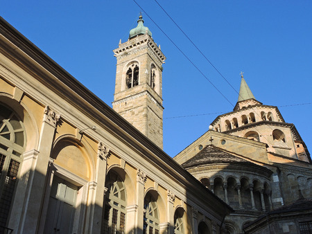 Bergamo - Old city (Citta Alta). One of the beautiful city in Italy. Lombardy. The bell tower and the dome of the Cathedral called Santa Maria Maggiore, north wing