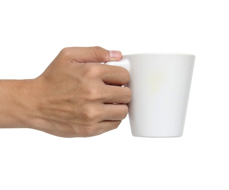 Man holding a ceramic cup isolated over white backgroundの写真素材