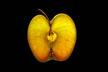 Photo pour Slice of Apple with Backlight Isolated on Black Background - image libre de droit