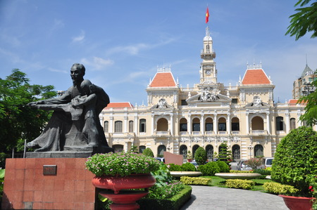 Statue of Ho Chi Minh and People s Committee Building in Ho Chi Minh City, Vietnam.