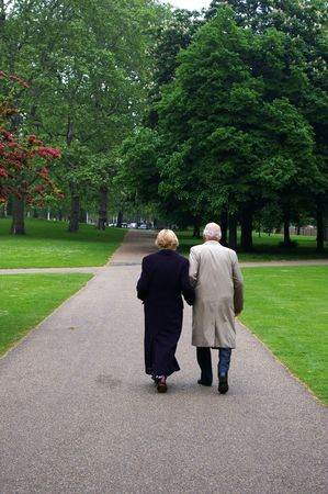 elderly married couple promenading in London's park