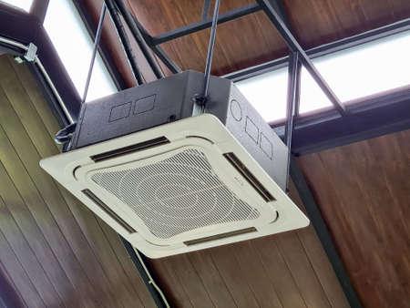 Photo pour Wooden ceiling mounted air conditioning system - image libre de droit