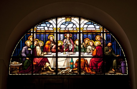 A stained glass window in Gibraltar showing the last supper.