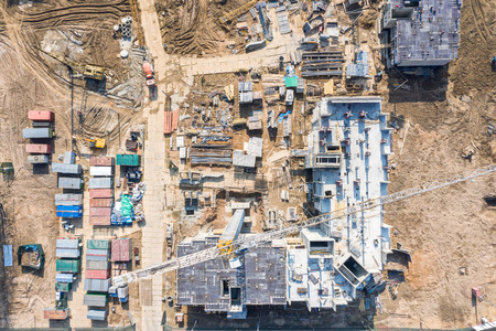 Photo pour construction of new residential buildings. aerial top view of city construction site with tower cranes - image libre de droit