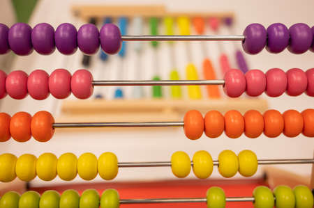Photo pour Bright colored hand abacus. Childrens wooden toy for the study of arithmetic. - image libre de droit