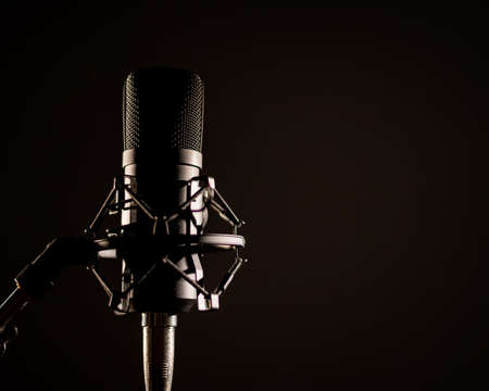 Photo for Close-up of a professional microphone for a radio broadcast on a black background. Recording studio equipment - Royalty Free Image