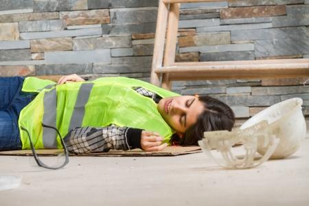 Photo pour Woman in accident at workplace - image libre de droit