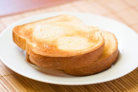 Thick sliced homemade bread broiled with butter