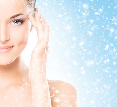 Photo pour Spa portrait of young and beautiful woman over winter Christmas background - image libre de droit