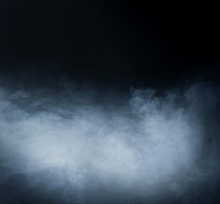 Photo pour Smoke over black background - image libre de droit