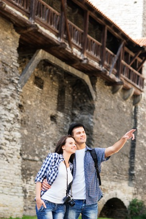 Young couple being tourists exploring the medieval buildings,の写真素材