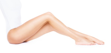 Foto de Close-up of beautiful, fit and sporty legs isolated on white. Health, sport, fitness, epilation, cellulite and hair removal, liposuction, healthy life-style. - Imagen libre de derechos
