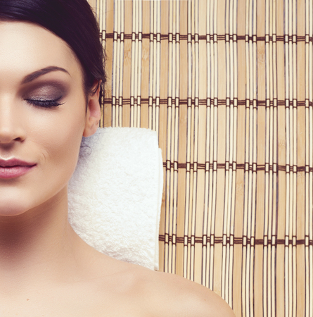 Healthy and beautiful woman getting massage treatment in spa salon.