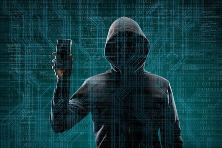 Foto de Dangerous hacker with a smartphone gadget over digital background with binary code. Obscured dark face in mask and hood. Data thief, internet attack, darknet fraud, virtual reality and cyber security. - Imagen libre de derechos
