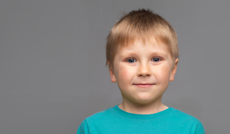 Photo for Portrait of happy smiling boy in blue t-shirt. Attractive kid in studio. - Royalty Free Image