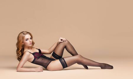 Photo pour Fashion model posing in erotic underwear. Woman in beautiful black lingerie over colored background. - image libre de droit