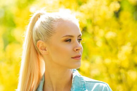 Photo for Portrait of young and beautiful teen girl at summer. Attractive blond woman over natural background. - Royalty Free Image