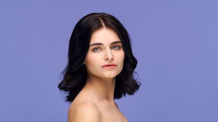 Foto de Studio portrait of young and beautiful brunette woman over background. Skin care, health, makeup and cosmetics. - Imagen libre de derechos