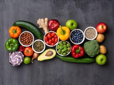 Photo pour Healthy eating ingredients: fresh vegetables, fruits and superfood. Nutrition, diet, vegan food concept. Concrete background - image libre de droit