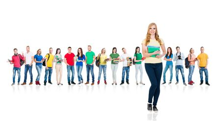 Photo pour Large group of teenage students isolated on white background. Many different people standing together. School, education, college, university. - image libre de droit