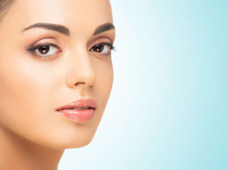 Foto de Beautiful face of young and healthy woman. Spa, cosmetology and healthcare. - Imagen libre de derechos