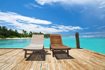 Wooden deck chairs on a tropical beach