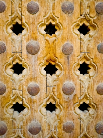 Wooden ornate door detail in Mandawa, Rajasthan, India