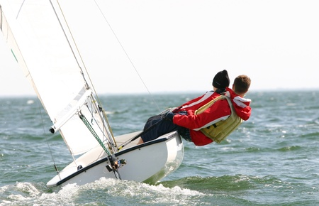 Two young dinghy sailors compete in regatta