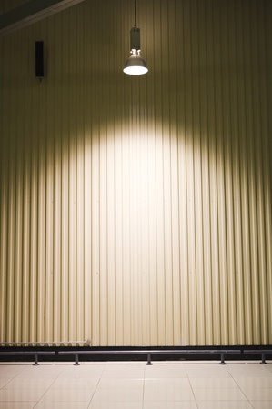 empty warehouse with a headlight on ceiling
