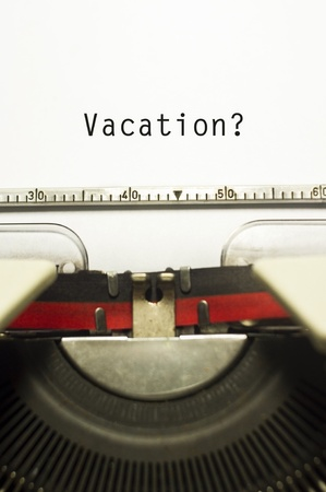 Photo pour concepts of vacations from work, with message on typewriter. - image libre de droit