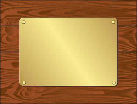 goldenl plate on dark wooden planks