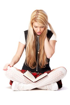 Beautiful teenage girl reading a book