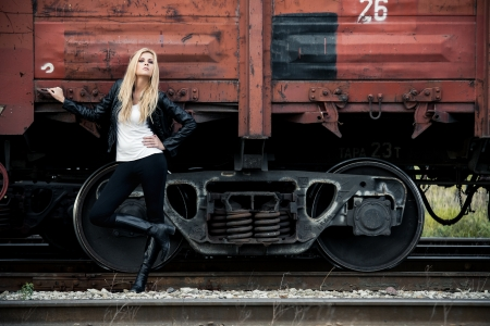 Young woman standing near a train