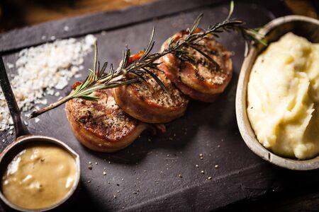 Photo pour Pork tenderloin served on a board in restaurant - image libre de droit