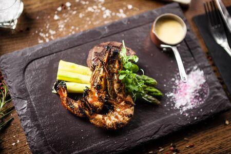 Photo for Tasting menu. Beef steak and grilled tiger prawns. - Royalty Free Image