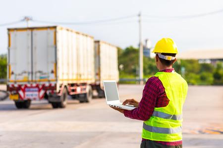 Foto de Foreman use computer for test and checking vehicle at industry. Working concept. - Imagen libre de derechos