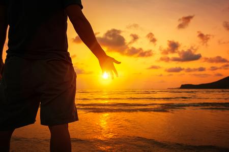 Photo pour Silhouette of Man Raising His Hands or Open arms  with sunset. - image libre de droit