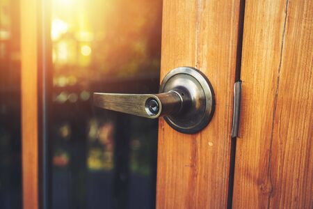 Photo for door knob on the wood door and light of sun. - Royalty Free Image