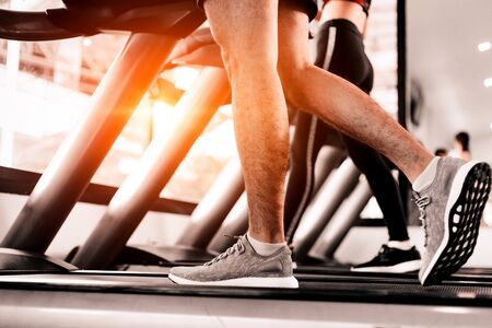 Photo for Close up foot  Fitness man running on track treadmill, exercise fitness. - Royalty Free Image