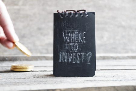 Where To Invest.Text and gold coins. Investor or business concept.