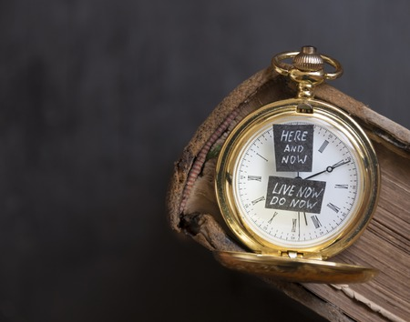 Here and Now and Live now do now text and antique gold pocket watch