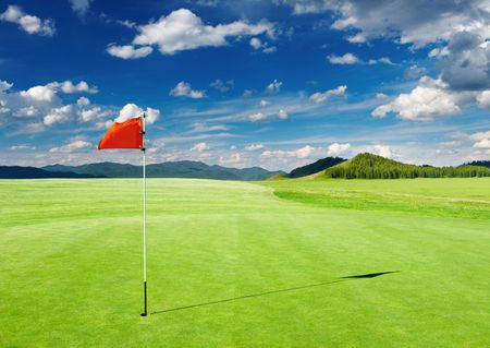 Photo for Golf field with red flag in the hole - Royalty Free Image