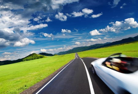Sports car in motion blur on empty road