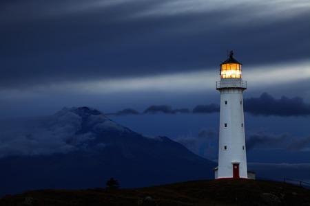 Cape Egmont Lighthouse and Taranaki Mount on background, New Zealand