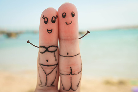 Happy couple have a rest on the beach in bathing suits