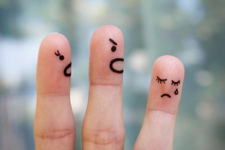 Foto de Finger art of family during quarrel. The concept of parents scolded her daughter, she was crying. - Imagen libre de derechos