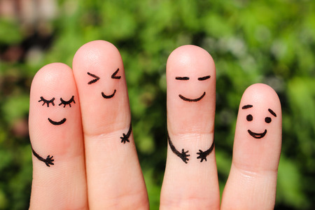 Finger art of friends. The concept of a group of people laughing.の写真素材